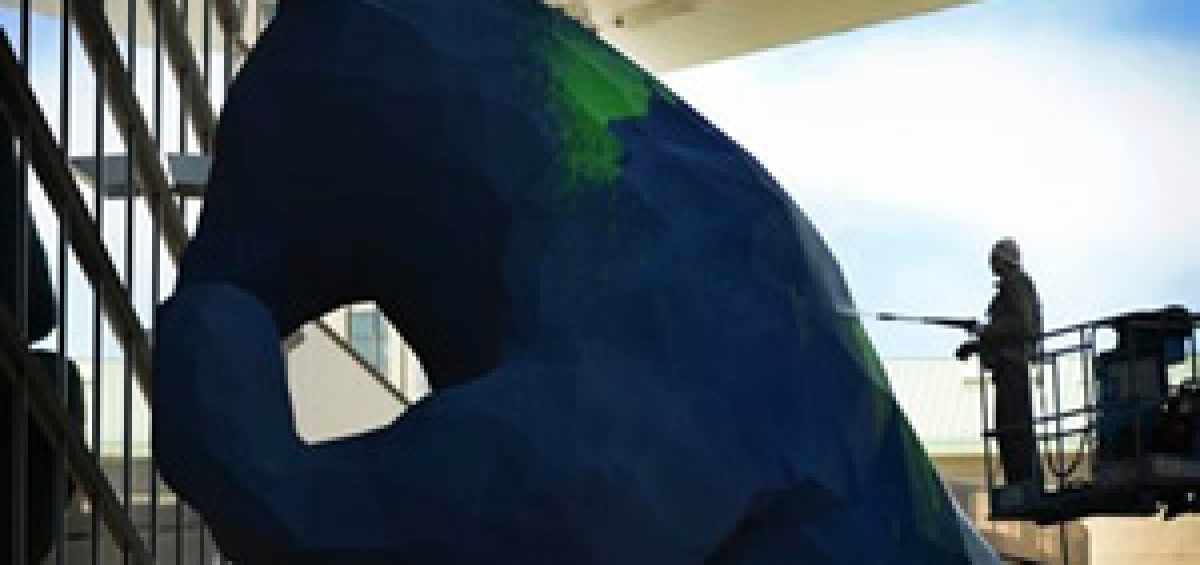 Fixing Big Blue Bear after vandalized