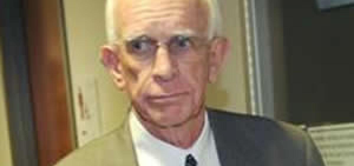Pat Sullivan in suit former Arapahoe County Sheriff
